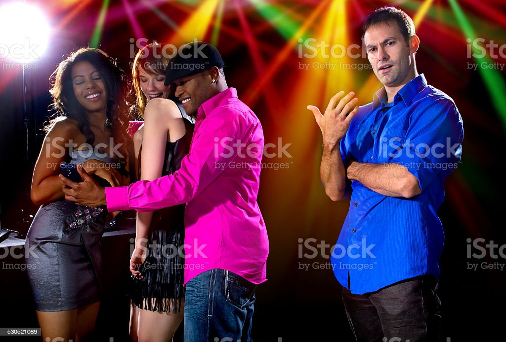 Pick Up Artist Being a Cock Blocker in a Nightclub stock photo