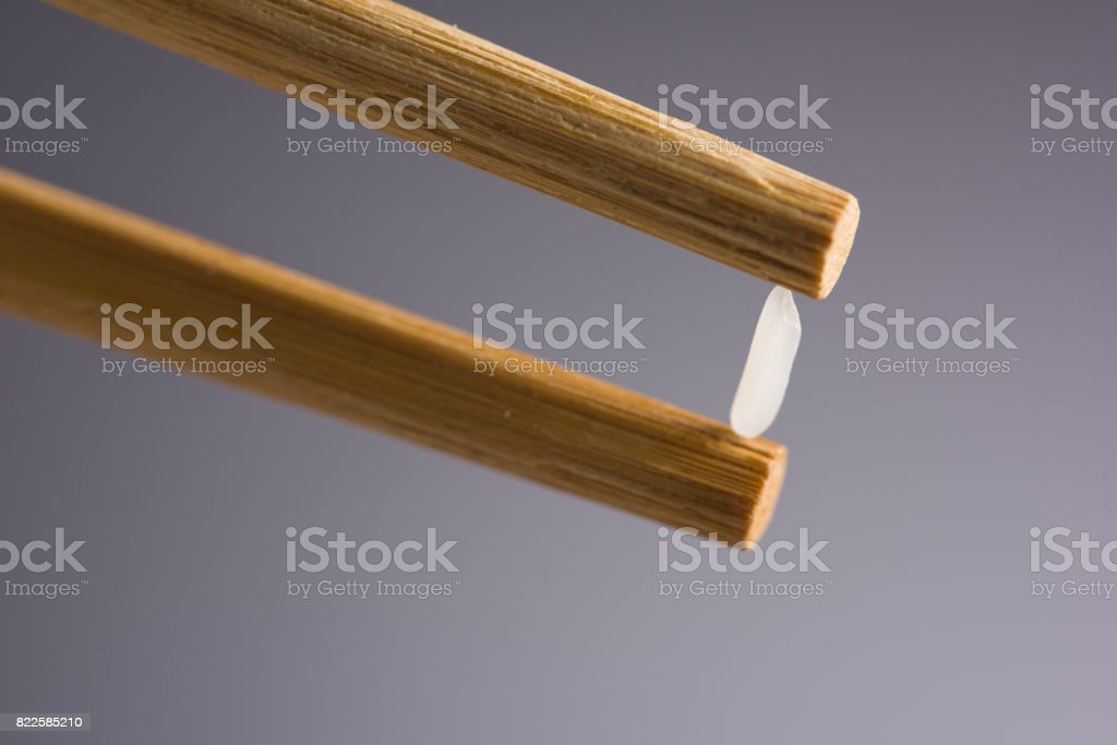 Pick up Rice with chopsticks stock photo