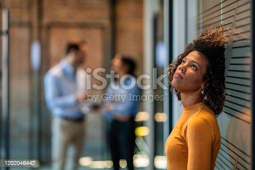 Photo of female Worker having headache. Dark-haired office worker having headache after been fired from work for no reason.
