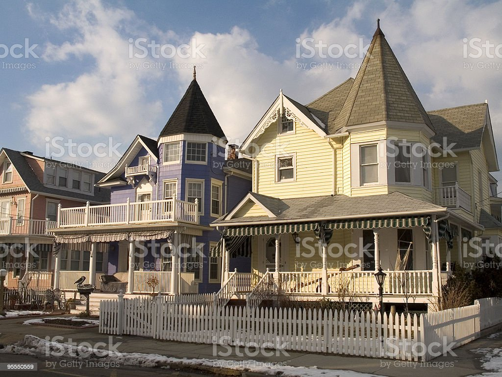 Picket Fence and Victorian Homes stock photo