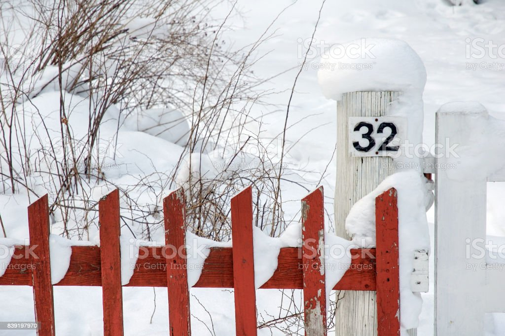 Picket fence in snow stock photo