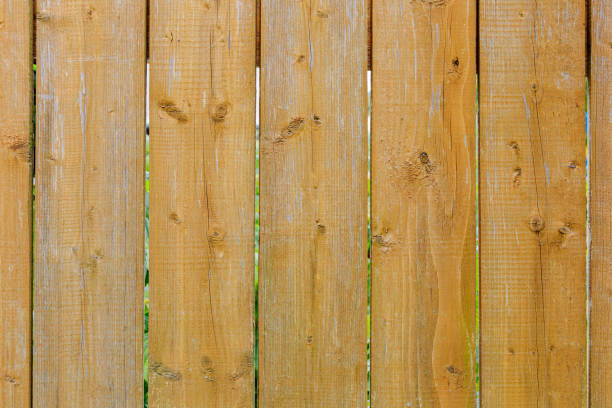Picket fence on the boundary of the garden. Textured background of wooden surface stock photo