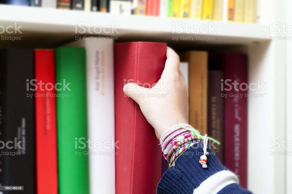 Picking a book royalty-free stock photo