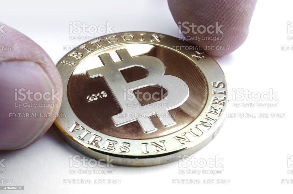 Picking up a Bitcoin royalty-free stock photo