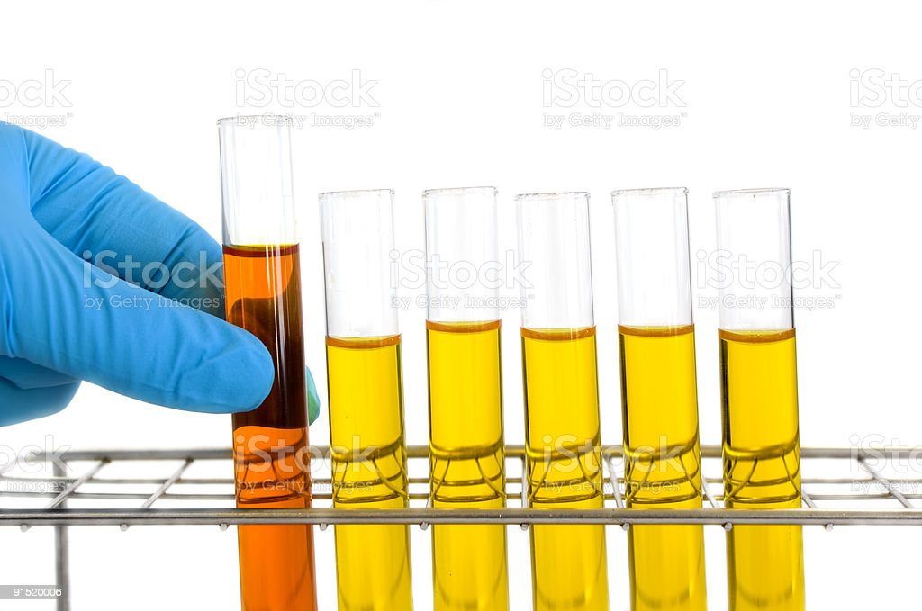 Picking up a test tube royalty-free stock photo