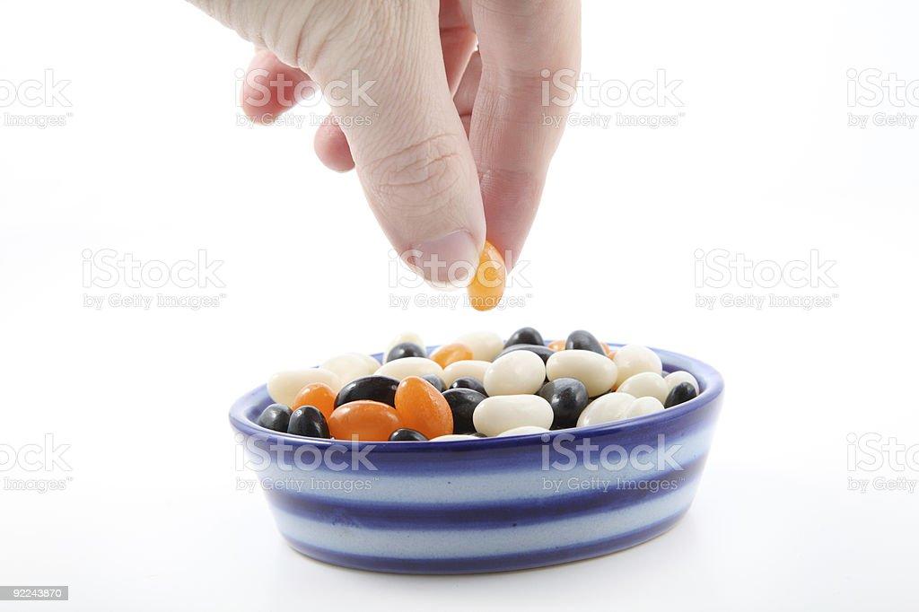 Picking Up an Orange Jellybean royalty-free stock photo