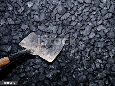 istock Picking up carbon with a shovel 1193805721