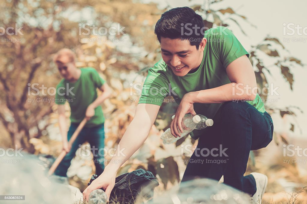 Picking up litter stock photo