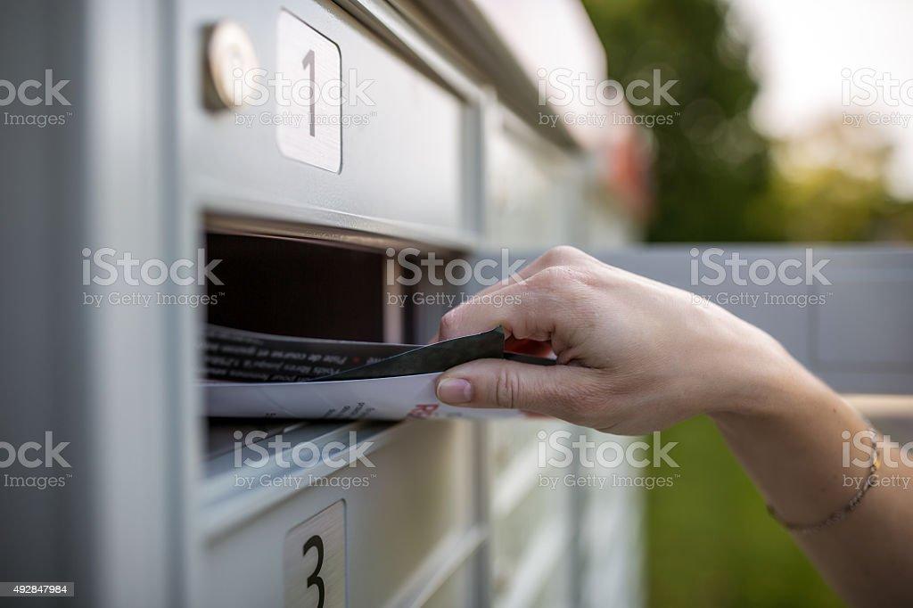 Picking up the Mail at Postal Mailbox stock photo