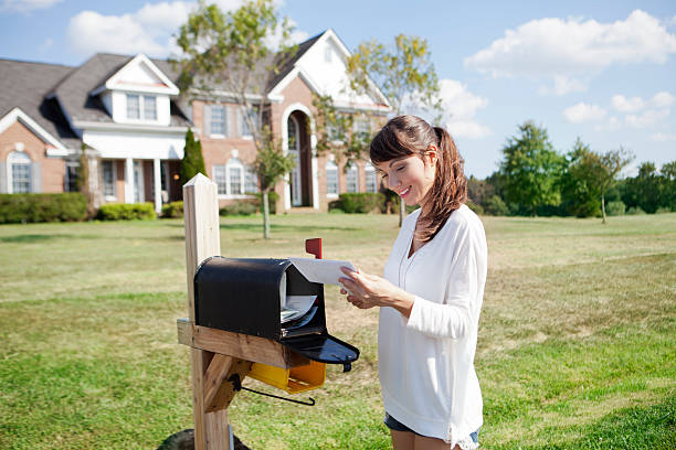 picking up the mail - mail stock photos and pictures