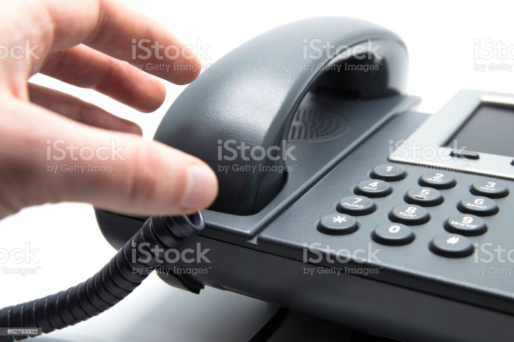 Picking up the phone stock photo