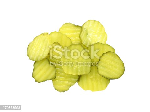 A pile of sliced dill pickles. Isolated on white.