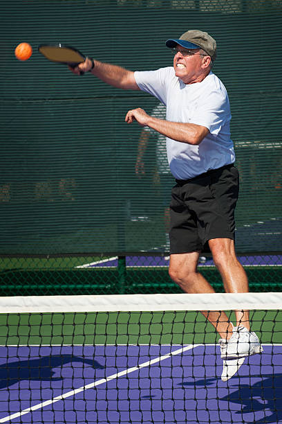 pickleball action - smash hit - table tennis racket stock pictures, royalty-free photos & images