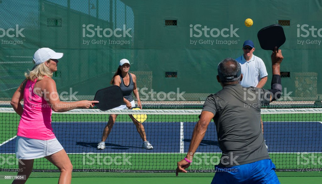 Pickleball - Mixed Doubles Action stock photo