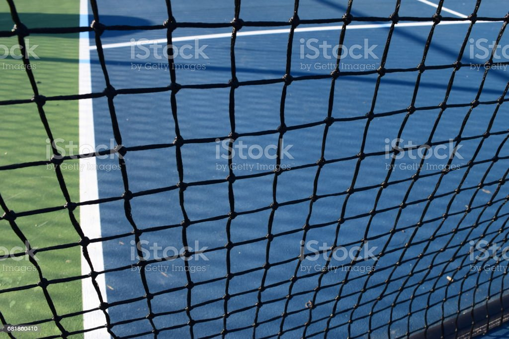 Pickleball netting on an empty court stock photo