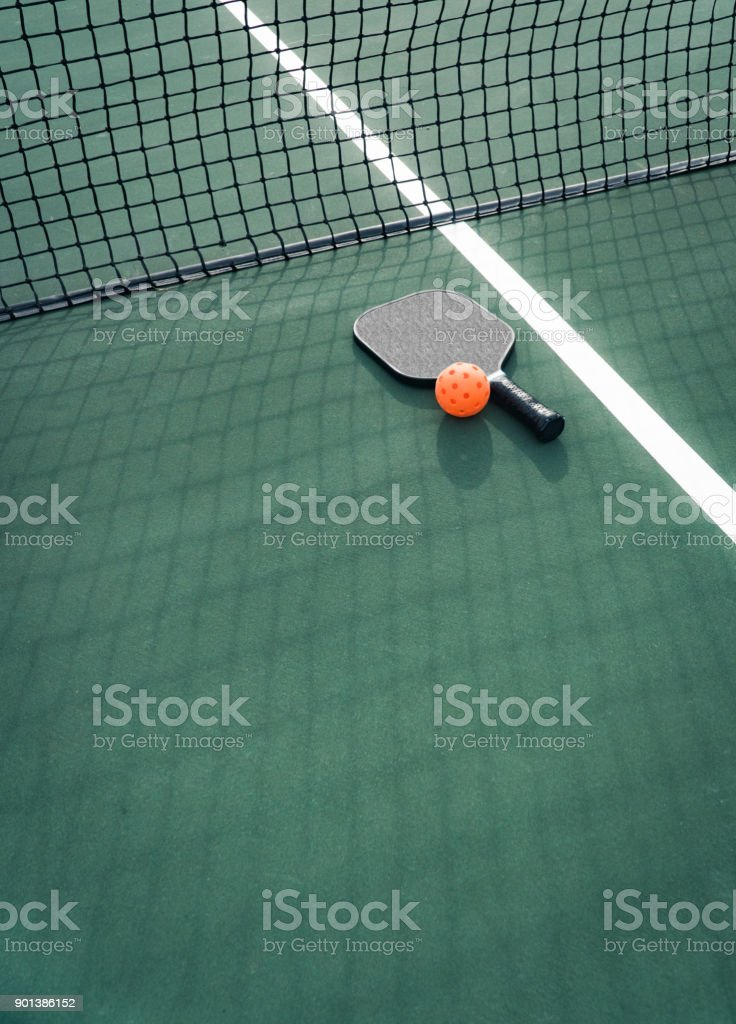 Pickleball paddle and ball stock photo