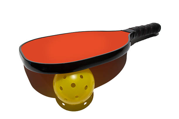 pickleball paddle resting on ball - table tennis racket stock pictures, royalty-free photos & images