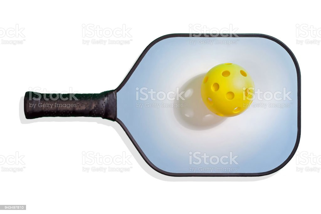 Pickleball Paddle with Yellow Pickleball royalty-free stock photo