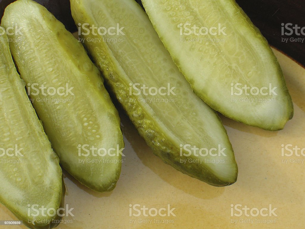 Pickled cucumber at the plate royalty-free stock photo