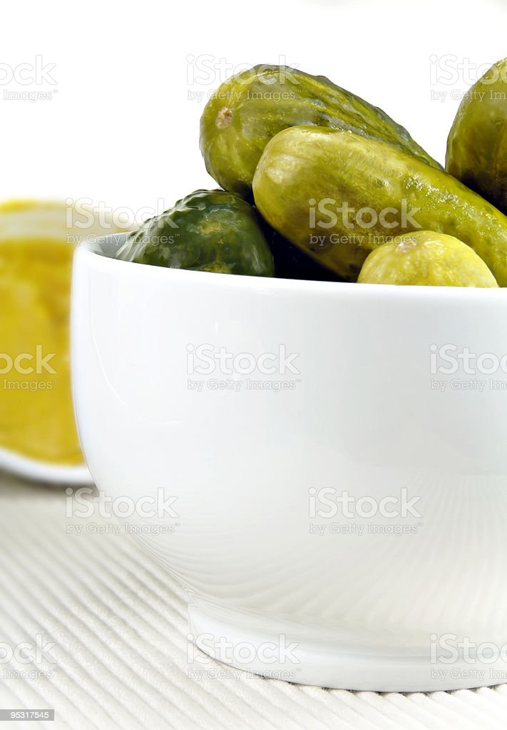 Pickled Cucumbers in a White Dish royalty-free stock photo
