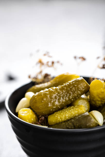 Pickled cucumbers, small marinated pickles, gherkins stock photo