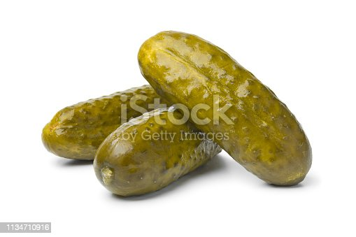 Whole pickled gherkins close up on white background