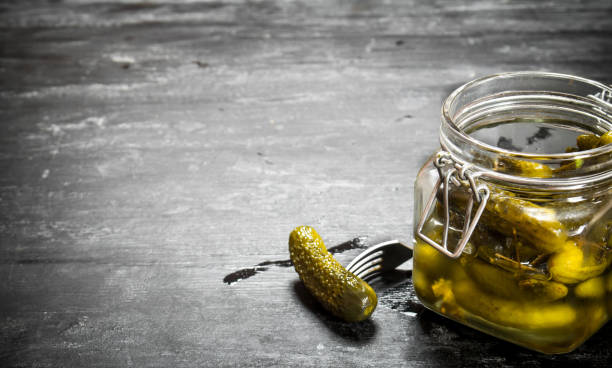 Pickled gherkins in a jar. stock photo