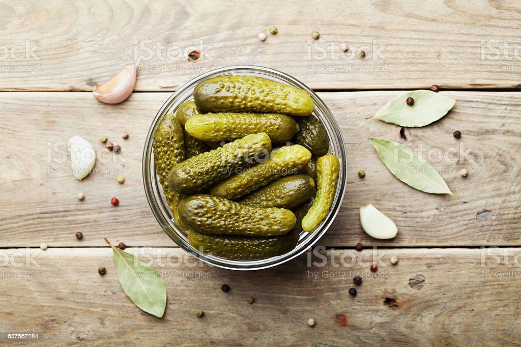 Pickled gherkins or cucumbers on wooden rustic table. Flat lay. – Foto