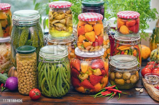 Freshly pickled organic vegetables in jars at home