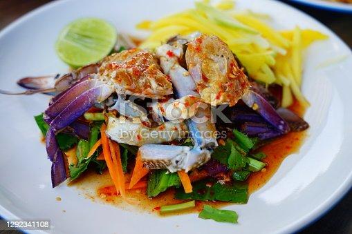 Close-up to pickled sea crab with herbs chili garlic lemon