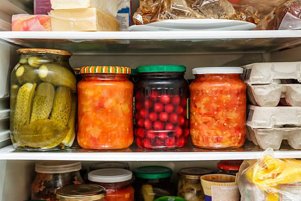 Pickled vegetables in jar stock photo