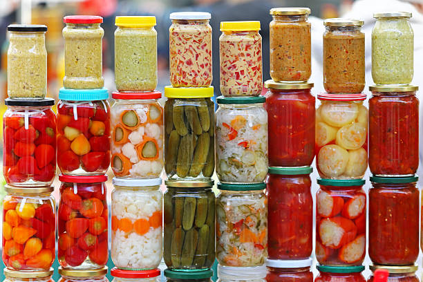 Pickled vegetables Pickled vegetables in mason jars ready for winter fermenting stock pictures, royalty-free photos & images