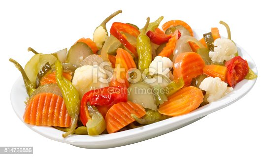 A plate of various pickled vegetables,isolated on white with clipping path.