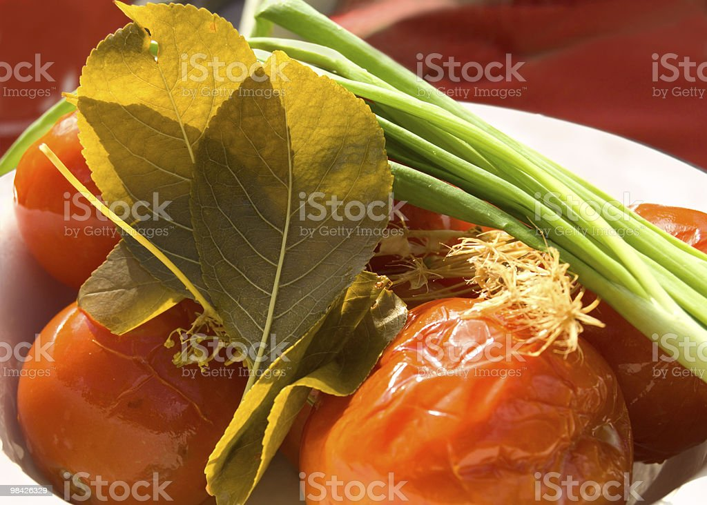 Pickles canned tomatoes royalty-free stock photo