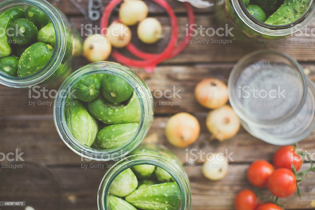 Pickling cucumbers. Garden table full of ingredients stock photo