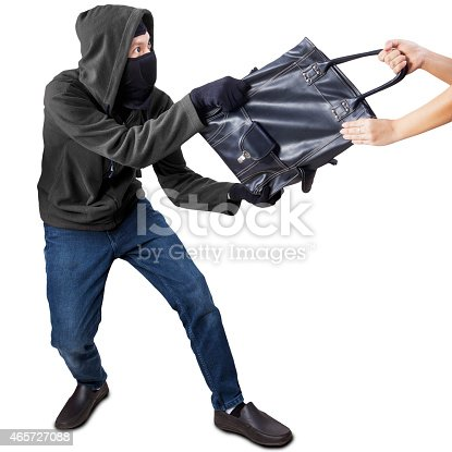 istock Pickpocket grabbing handbag from a woman 465727088