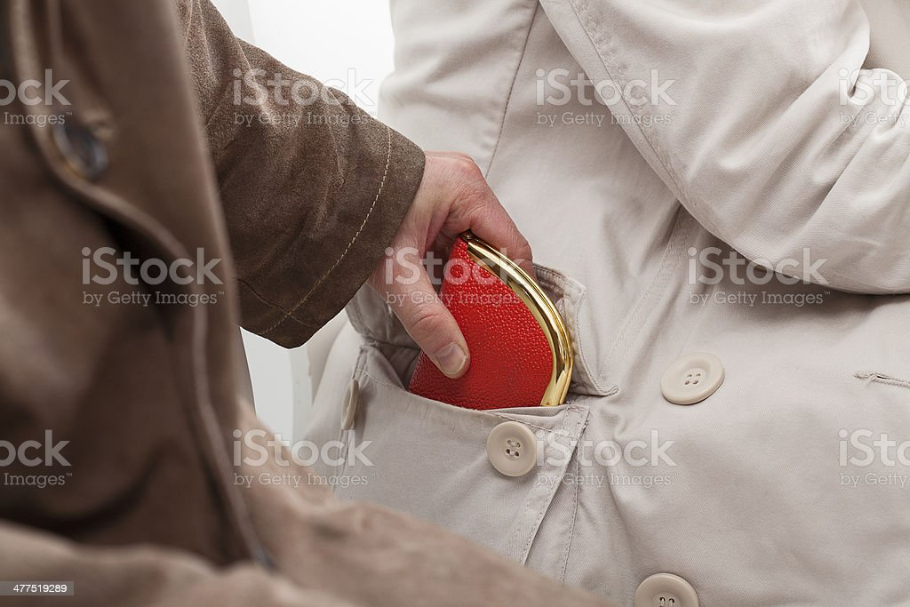 Pickpocket stealing a wallet stock photo