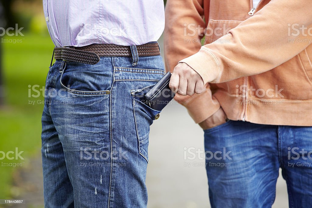 Pickpocket stealing wallet stock photo
