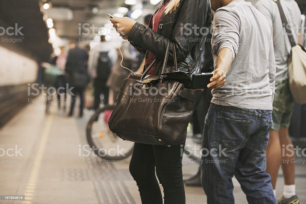 Pickpocketing at the subway station stock photo