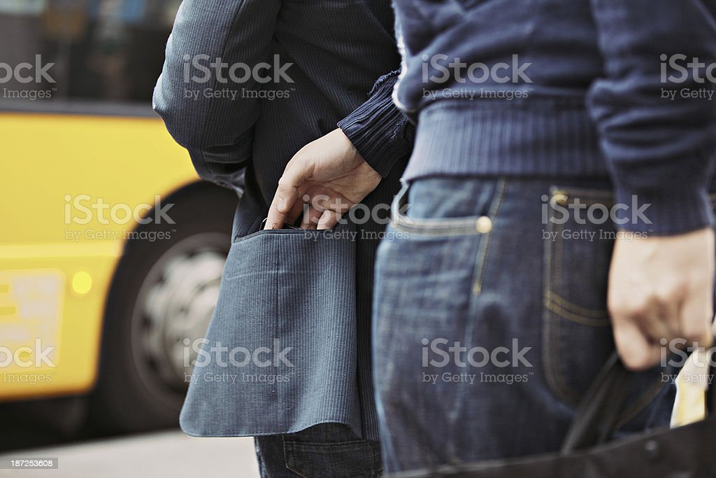 Pickpocketing on the street during daytime stock photo