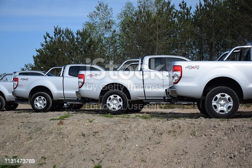 133277230 istock photo Pick-up cars in a row 1131473769