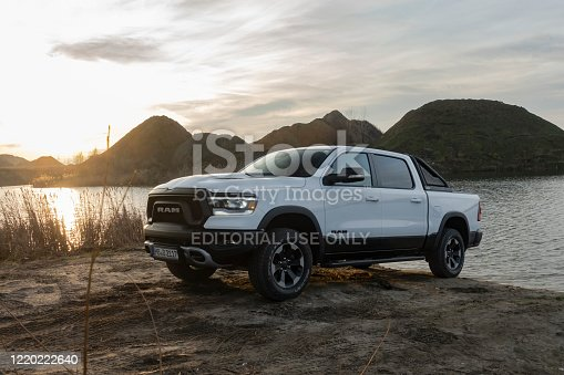 Berlin, Germany - 12 January, 2020: RAM 1500 Rebel stopped next to lake in a sunset. RAM is one of the most popular pickup vehicles in North America.