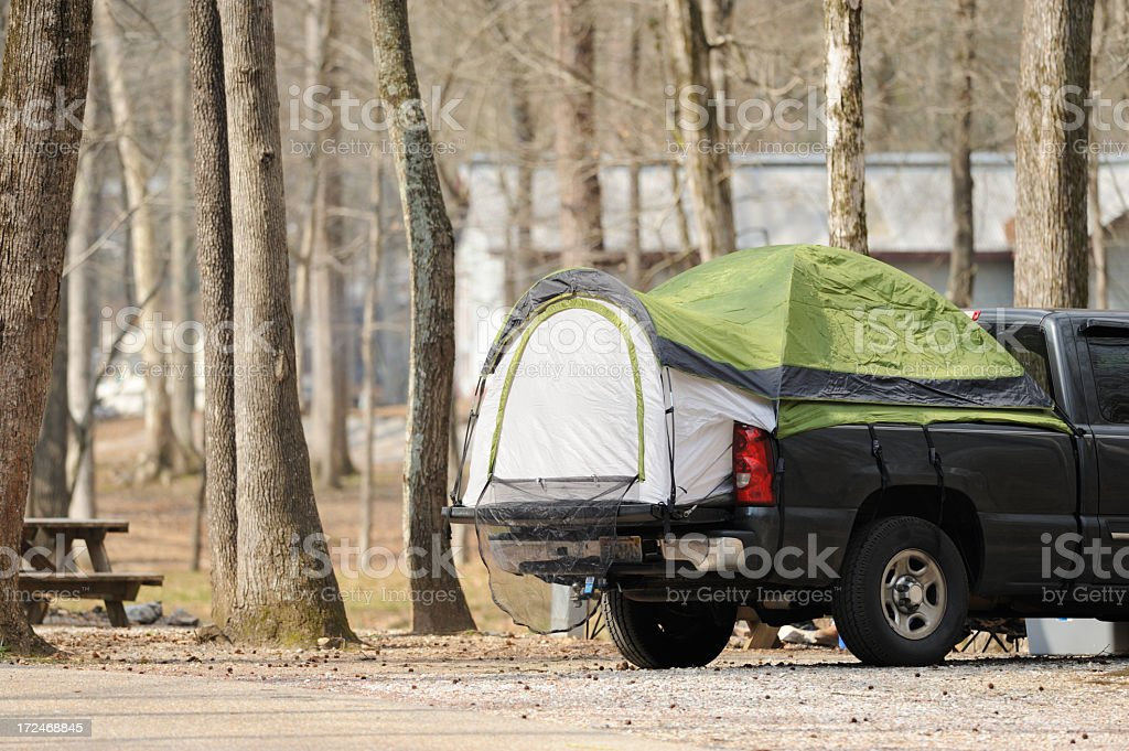 Pickup truck bed tent in campground royalty-free stock photo