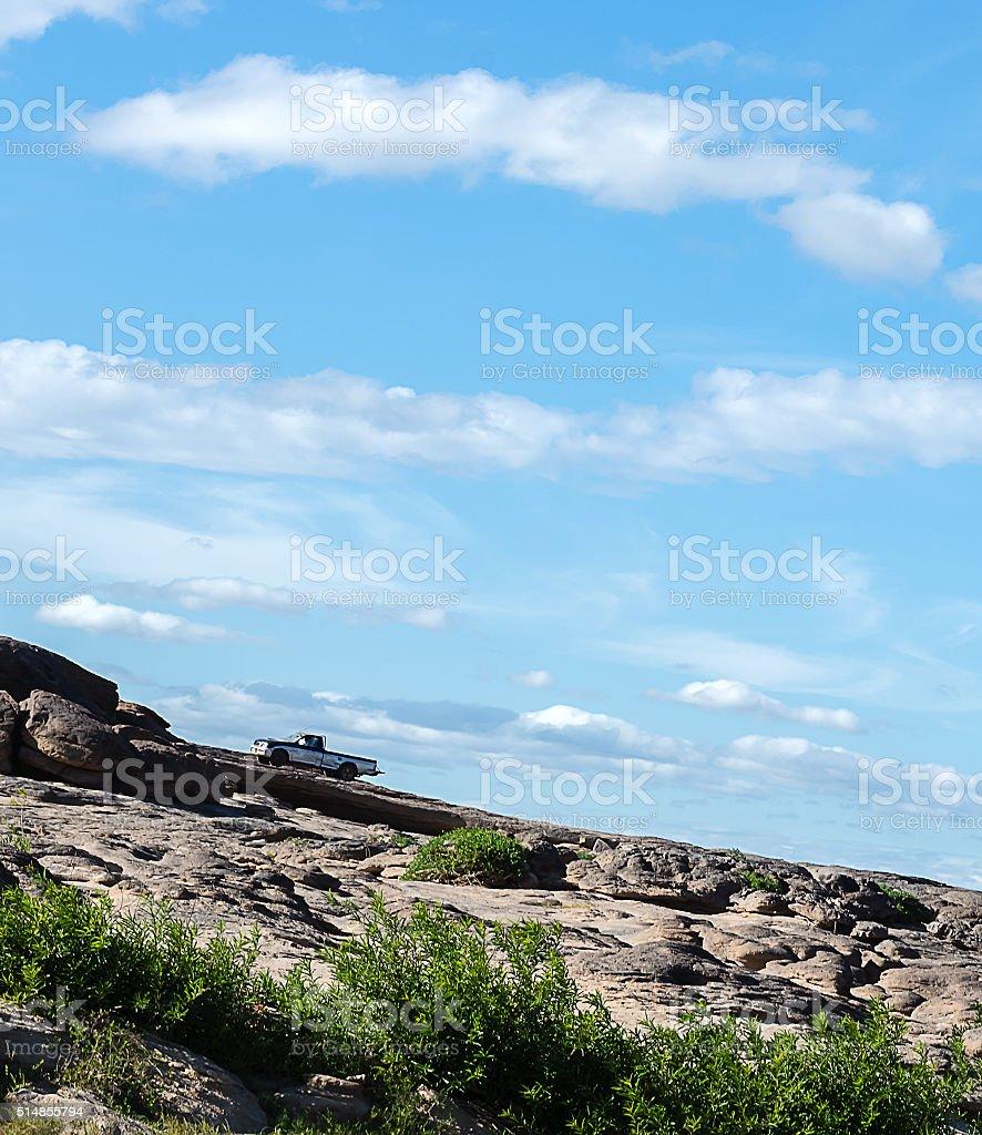 Pickup truck climbing a steep hill stock photo