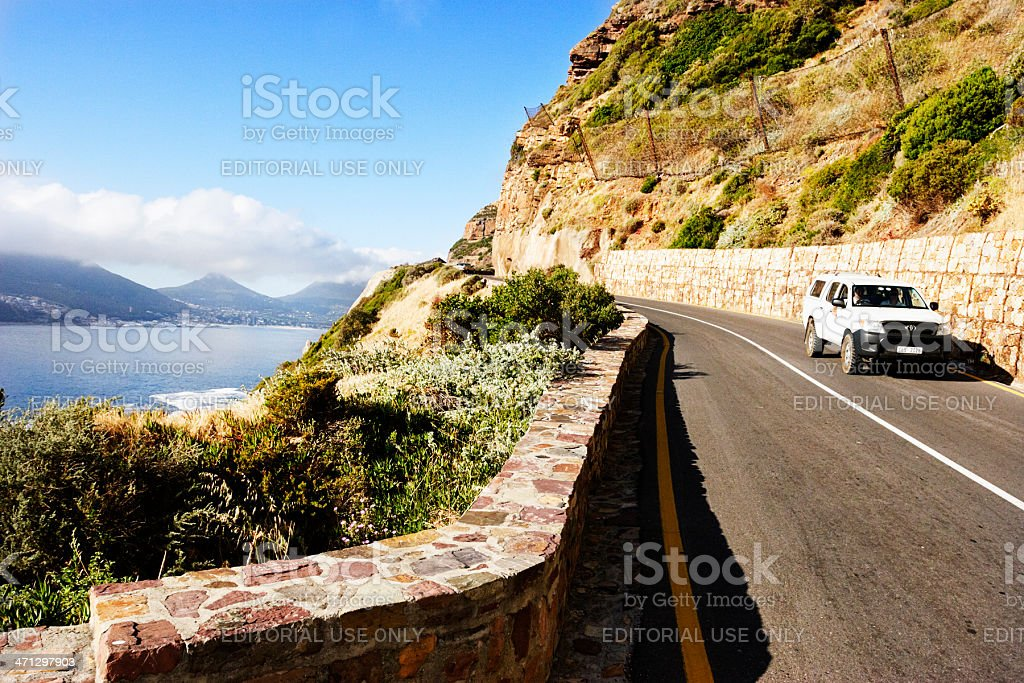 Pick-up truck driving along Chapmans Peak Drive, Cape Town royalty-free stock photo