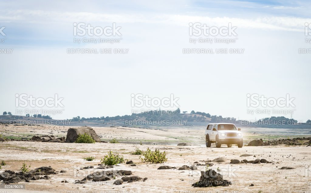 Pickup Truck travels through drought-stricken Folsom Lake stock photo