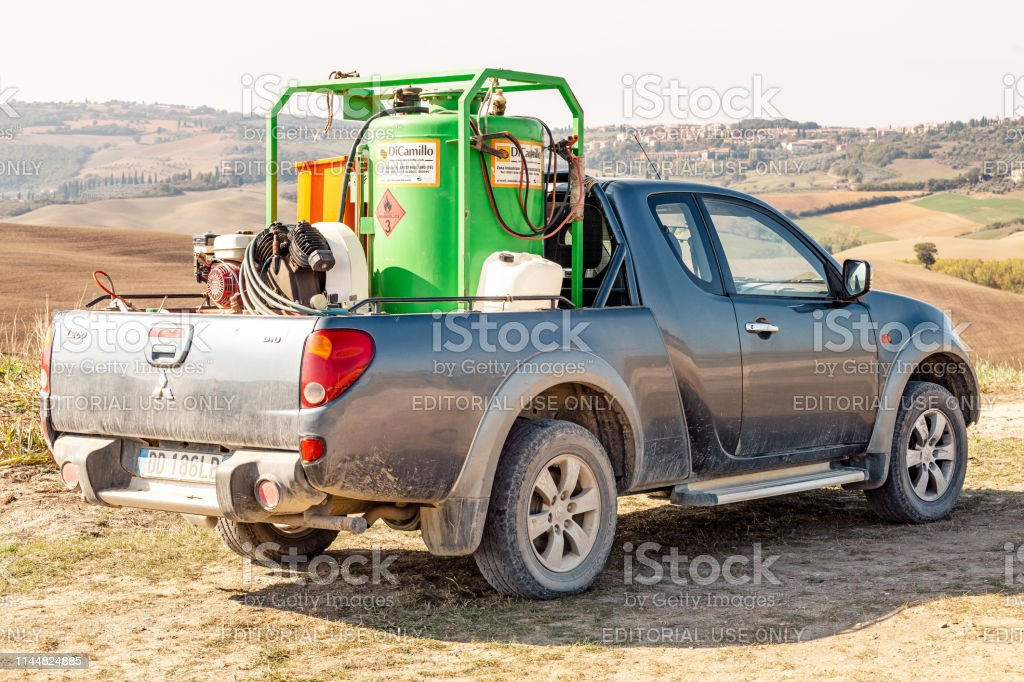 Pickup truck with Agricultural Spraying chemicals and equipment