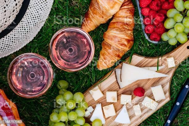 Picnic at the park on the grass cheese raspberry grape croissant picture id1168757563?b=1&k=6&m=1168757563&s=612x612&h=zmolomyewjtv3dpbir4dy3n2wm4m51 2e wjh72uybk=