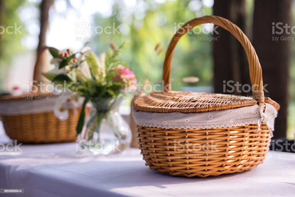 picnic basket and table place stock photo