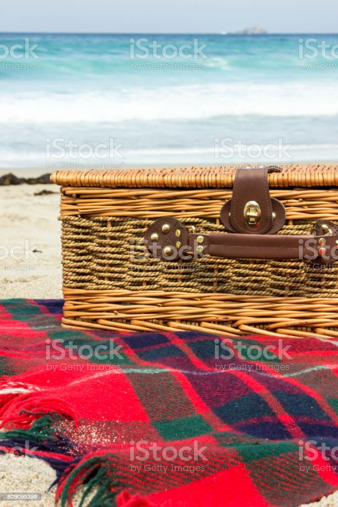 Picnic basket by the seaside stock photo